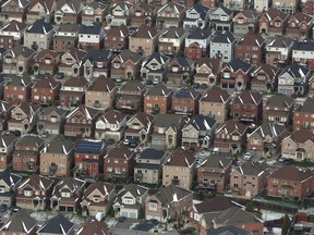 "An aerial view of houses in Oshawa, Ont. The Bank of Canada says housing resales and price growth had ""slowed significantly"" in Toronto and Vancouver over the past two years."