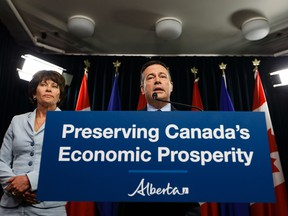 Premier Jason Kenney (right) speaks beside Energy Minister Sonya Savage about Bill 12, the turn-off-the-taps legislation, during a press conference in the media room in the Alberta Legislature in Edmonton, on Wednesday, May 1, 2019.