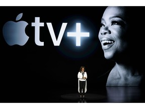 FILE - In this March 25, 2019, file photo Oprah Winfrey speaks at the Steve Jobs Theater during an event to announce new Apple products in Cupertino, Calif. Apple users will be able to subscribe to HBO, Showtime and a handful of other channels directly through Apple's new TV app, bypassing the need to download or launch a separate app. The new capabilities available Monday, May 13, come ahead of Apple's plan to offer its own original shows, including ones from Oprah Winfrey and Steven Spielberg.