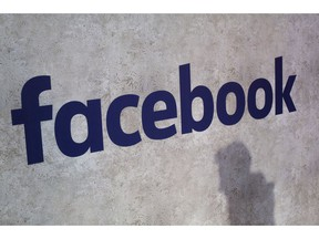 FILE - This Jan. 17, 2017, file photo shows a Facebook logo displayed in a start-up companies gathering at Paris' Station F in Paris. Facebook CEO Mark Zuckerberg will meet Friday May 10, 2019 French President Emmanuel Macron as the tech giant and France try to pioneer ways of fighting hate speech and violent extremism online.