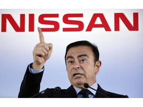 FILE - In this May 11, 2012, file photo, then Nissan Motor Co. President and CEO Carlos Ghosn speak during a press conference in Yokohama, near Tokyo. Nissan is seeing sales and profits tumble, as its once revered former chairman, Carlos Ghosn, awaits trial on charges of financial misconduct. The Japanese automaker says it is beefing up corporate governance and sticking with its alliance with French partner Renault SA.