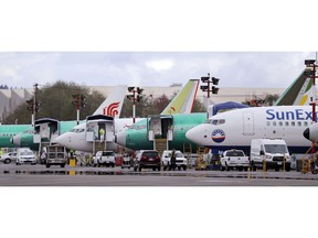 FILE - In this April 8, 2019, file photo, Boeing 737 Max aircraft are parked at the airport adjacent to a Boeing Co. production facility in Renton, Wash. From airplanes made by Boeing to apples, cherries and wheat grown by farmers, no other state is more dependent on international trade than Washington. As the tariff disputes escalate, small factories are closing and manufacturing behemoths like Boeing are increasingly worried about access to crucial Asian markets that have helped propel the state's booming economy.