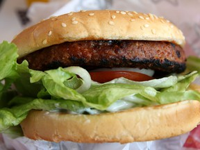 """Aiming to satisfy demands of the so-called flexitarians, Tyson half-plant half-beef burger will have """"fewer calories and less saturated fat"""" than other pure plant-based burgers, the company says. A Beyond Meat burger, above."""