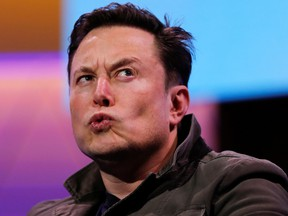 """SpaceX owner and Tesla CEO Elon Musk reacts during a conversation with legendary game designer Todd Howard at the E3 gaming convention in Los Angeles in June. Musk promised last year that Tesla Inc would be profitable and cash flow positive """"henceforth."""""""