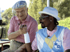 Former Chrysler Corp. chairman Lee Iacocca and rapper Snoop Dogg in a 2005 Chrysler ad.