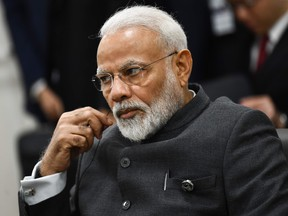 India's Prime Minister Narendra Modi attends a meeting with US President Donald Trump and Japanese Prime Minister Shinzo during the G20 Osaka Summit in Osaka on June 28, 2019.