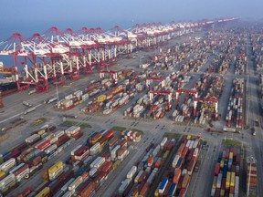 Gantry cranes and containers stand at the Yangshan Deepwater Port, operated by Shanghai International Port Group Co., in this aerial photograph taken in Shanghai, China, on Aug. 7, 2019.