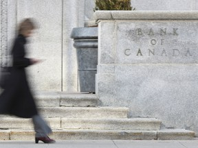 This file photo taken on April 12, 2011 shows a woman walking past the Bank of Canada building in Ottawa.