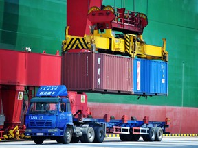 Containers are transferred at a port in Qingdao in China's eastern Shandong province.