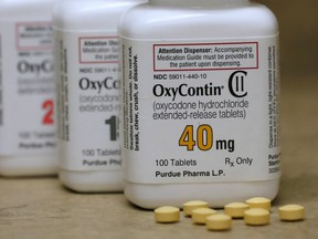 Bottles of prescription painkiller OxyContin, made by Purdue Pharma, sit on a counter at a local pharmacy in Provo, Utah, U.S., April 25, 2017.