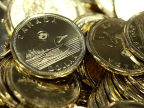 Canadian one dollar coins sit in a pile at the Royal Canadian Mint Ltd. manufacturing facility in Winnipeg, Manitoba, Canada, on Monday, March 11, 2019.