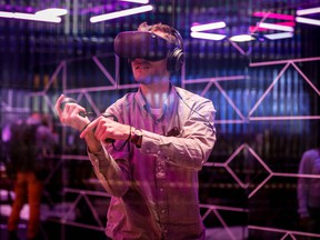 In this file photo taken on April 30, 2019 An attendee tries out the new Oculus Quest Virtual Reality (VR) gaming system at the Facebook F8 Conference at McEnery Convention Center in San Jose, California.