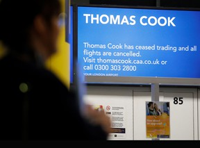 Passengers walk past the closed Thomas Cook check-in desks at the South Terminal of London Gatwick Airport in Crawley, south of London on September 23, 2019, after the company announced it was taking steps to enter into compulsory liquidation with immediate effect.