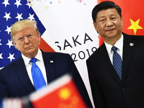 In this file photo taken on June 29, 2019 Chinese President Xi Jinping, right, and U.S. President Donald Trump attend their bilateral meeting on the sidelines of the G20 Summit in Osaka, Japan.