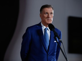 Maxime Bernier, leader of the People's Party of Canada, listens to members of the media following the federal leader's debate in Gatineau, Quebec.