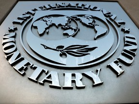 The International Monetary Fund's headquarters in Washington. The latest dimming of the outlook, just before annual meetings of the IMF and World Bank in Washington this week, reflects the economic costs of higher tariffs.