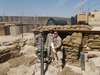 Jason Hsiung, right, holding a mortar during service in Afghanistan.