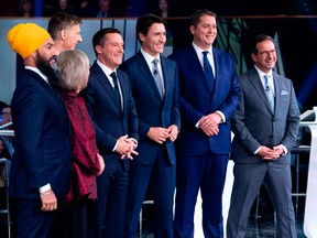 Federal party leaders, NDP leader Jagmeet Singh, Green Party leader Elizabeth May, People's Party of Canada leader Maxime Bernier, host Patrice Roy from Radio-Canada, Prime Minister and Liberal leader Justin Trudeau, Conservative leader Andrew Scheer, and Bloc Quebecois leader Yves-Francois Blanchet pose for pictures before the Federal leaders French language debate at the Canadian Museum of History in Gatineau, Quebec on October 10, 2019.