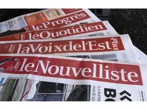 A selection of newspapers owned by Groupe Capitales Medias (GCM) are pictured in Montreal on August 19, 2019.