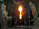 Workers at Detour Gold pour metal.