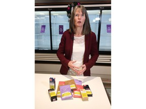 """Nova Scotia Liquor Corp. spokeswoman Bev Ware shows off a selection of infused teas and vaping products at the Nova Scotia Liquor Corp. Cannabis in Halifax on Tuesday, Dec. 24, 2019. Stocking stuffers with a kick are moving briskly off the shelves at Nova Scotia's government operated cannabis shops in the leadup to Christmas. In a viewing of Nova Scotia Liquor Corp.'s early offerings of various """"edibles"""" products, spokeswoman Bev Ware notes quite a few cupboards were already bare."""