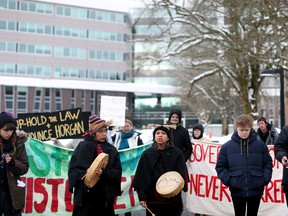 Supporters of the Wet'suwet'en Nation who oppose the construction of the Coastal GasLink pipeline, protest outside the provincial headquarters of the Royal Canadian Mounted Police (RCMP) in Surrey, British Columbia, January 16, 2020.