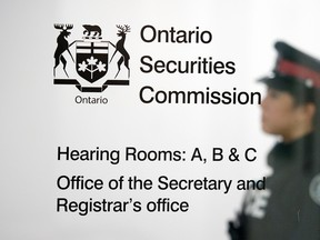 A Toronto Police Services officer at the Ontario Securities Commission.