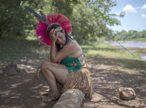 An Indigenous woman from the Pataxo Ha-ha-hae community cries while looking at the Paraopeba river covered in mud, on the sixth day after the collapse of a dam at an iron-ore mine belonging to Brazil's giant mining company Vale near the town of Brumadinho, state of Minas Gerais, southeastern Brazil, on January 30, 2019.