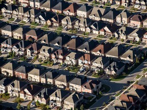 Homes stand in this aerial photograph taken above Toronto, Ontario. Some are concerned that lower interest rates will fuel froth in Canada's housing market.