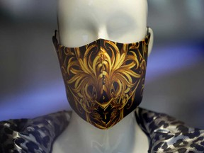 A mannequin in a shop window wears a fashionable protective face mask during the coronavirus crisis.