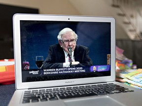 Warren Buffet, chairman and chief executive officer of Berkshire Hathaway Inc., speaks during the virtual Berkshire Hathaway annual shareholders meeting seen on a laptop computer in Arlington, Virginia, U.S., on Saturday, May 2, 2020.