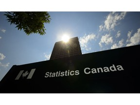 Statistics Canada building and signs are pictured in Ottawa on Wednesday, July 3, 2019. Statistics Canada will say this morning how the economy fared in May and provide its preliminary estimate for June to give a picture of the first half of a year marked by the COVID-19 pandemic.