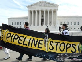 Climate activists protest the Atlantic Coast Pipeline in front of the U.S. Supreme Court in February.