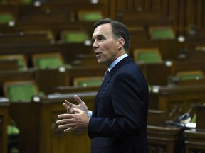 Finance Minister Bill Morneau rises during a meeting of the Special Committee on the COVID-19 pandemic in the House of Commons on Parliament Hill in Ottawa, on Wednesday, June 17, 2020. Federal and provincial governments have agreed to extend a commercial rent relief program to help cover July costs for eligible small businesses, with a few changes.