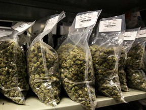Packages of marijuana are seen on shelf before shipment at the Canopy Growth Corp. facility in Smith Falls, Ontario.