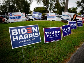 Campaign signs are seen at Westchester Regional Library in Miami, Florida on October 19, 2020.
