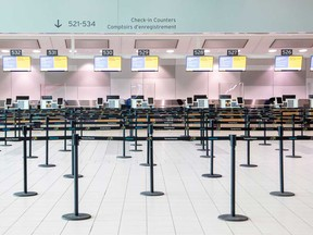 An empty check-in counter at Toronto Pearson International Airport. Air passenger traffic plummeted nearly 90 per cent this summer.