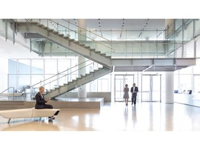Lobby of an office building facing the entrance with persons walking into the building.