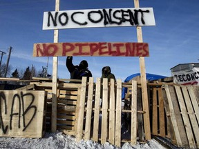Protesters block a rail line in Edmonton in solidarity with Wet'suwet'en hereditary chiefs, on Feb. 19, 2020.