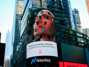 The Airbnb logo is displayed on the Nasdaq digital billboard in Times Square in New York on Dec. 10, 2020.