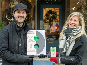 Damian and Tara Wright stand with their invention TraffikFlo outside Home Smith, an interior design store, in Toronto.