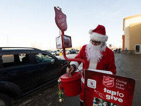 Santa Claus collects donations for The Salvation Army at the Stony Plain Walmart in Edmonton, on  Dec. 16, 2020.