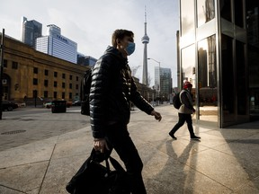 Pedestrians in downtown Toronto during the start of the city's second lockdown in November.