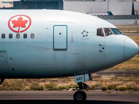 Air Canada said on Wednesday it will cut its first-quarter capacity by an additional 25 per cent, resulting in a workforce reduction of about 1,700 employees.