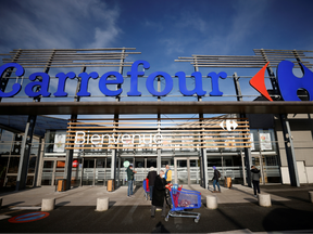 Customers walk past a Carrefour Hypermarket store in Saint-Herblain near Nantes, France January 15, 2021.