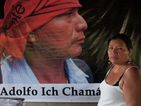 Angelica Choc stands in front of a banner with an image of her slain husband, former Q'eqchi' Mayan community leader, teacher and anti-mining activist Adolfo Ich Chaman, on the fifth anniversary of his murder.