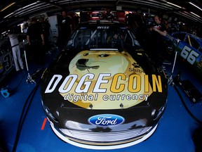 The #98 Dogecoin / Reddit.com Ford, driven by Josh Wise, is seen in the garage during practice for the NASCAR Sprint Cup Series Aaron's 499 at Talladega Superspeedway on May 2, 2014 in Talladega, Alabama.