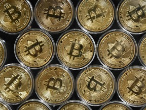The first exchange-traded fund tracking Bitcoin in North America begins trading in Toronto on Thursday.
