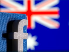 A 3D printed Facebook logo is seen in front of Australia's flag.