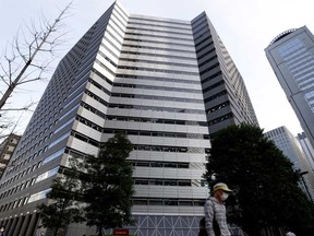 Nomura Holdings Inc. headquarters, in Tokyo. Nomura said it faced a possible US$2 billion loss due to transactions with a U.S. client.